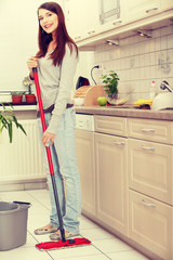 Woman holding a mop
