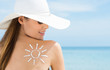 Sun Drawn On Woman's Shoulder With Sun Protection Cream