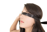 hispanic woman covering her eyes with a blindfold