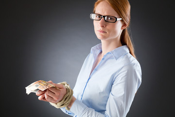 Sad Woman with Tied Hands Holding Money
