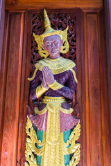 The angels are carved in the door of the temple , Shan style