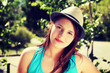Young beatiful woman in summer hat.