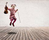 little girl with violin jumping