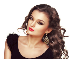 Beautiful fashion brunette woman with long curly hairs flutterin