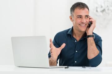 Smiling Man Talking On Cellphone
