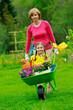 Garden, planting - girl helping mother in the garden