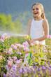 Garden, watering - girl watering roses