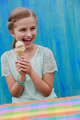 Summer sweets - lovely girl eating icecream