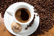 Cup of coffee and coffee beans,