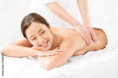 Massage. Close-up of a Beautiful Woman Getting Spa Treatment