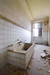 Old abandoned bath with window