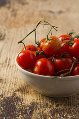 Fresh Organic Cherry Tomato on rustic wooden table