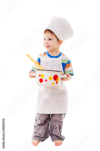 Little cook standing with ladle and pan