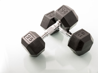Dumbells over white background and with reflections