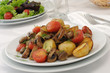 Baked mushrooms with tomatoes and potatoes