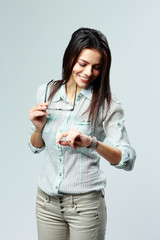 businesswoman looking at her watch on wrist