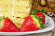 Fresh juicy strawberries with pancakes on a wooden table