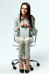 businesswoman sitting on office chair
