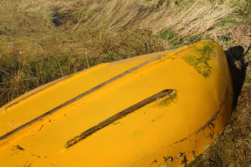 Upturned yellow row boat