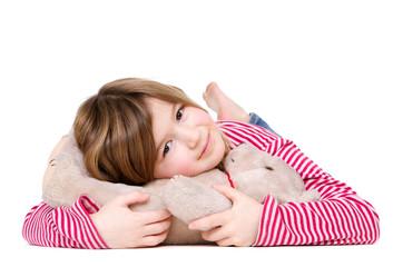 Adorable young girl holding teddy bear