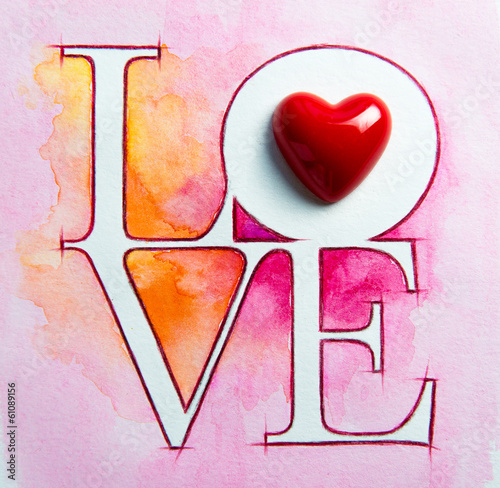 Word LOVE over abstract watercolor painting and red heart