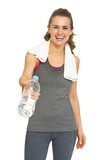Fitness young woman giving bottle of water