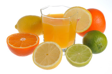 Citrus mix with the glass filled with citrus juice isolated on w