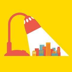 Illustration: a big city under the light of a desk lamp