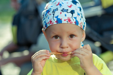 cute little boy licking ice cream and ate ice cream stick