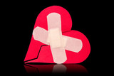 Broken heart fixed with adhesive bandage