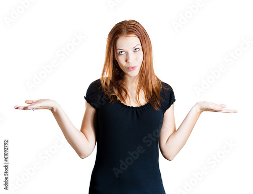 Puzzled, clueless woman shrugging her shoulders, doesn't care
