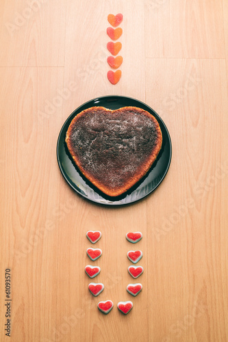 I love you words written with gummies and cake on wood backgroun