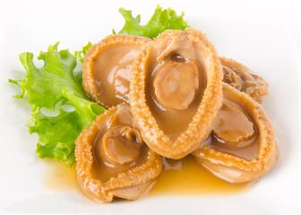 Abalones. Chinese cuisine abalone on background.