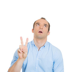 Annoyed man, being sarcastic showing peace sign, tired