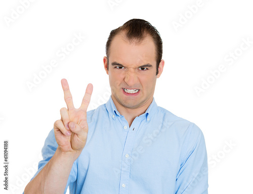 Sarcastic man giving victory, peace sign