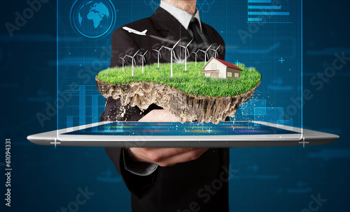 Businessman presenting a perfect ecology land with a house and w