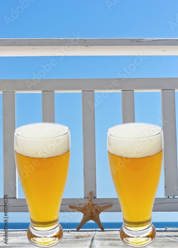 beer glass on terrace with star fish