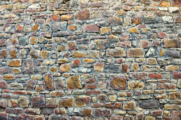 Gray stones of medieval wall in center of Huy