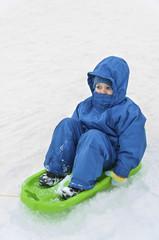 Children on sled in winter