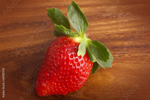A ripe red strawberries on wooden table