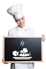 Köchin mit Hinweis auf gesunde Ernährung
