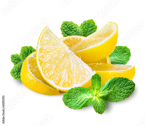 Lemon slices isolated on white. Heap of fruits