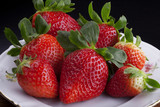 Strawberries on white plate