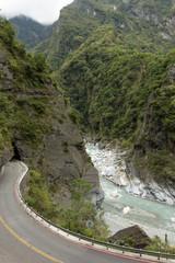 Landscape of empty road, river and steep mountain at Taroko