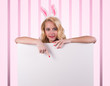Bunny girl with  banner on pink and white striped background.
