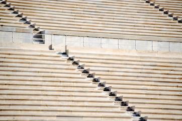 Rows of stone seats at stadium