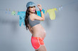 Young sporty pregnant woman.