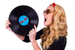 Isolated Pin-up girl touching vinyl LP with tongue
