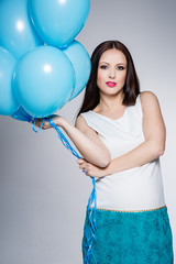 Pregnant woman with blue balloons