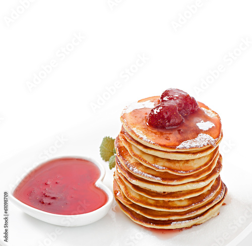 Delicious pancakes with strawberry jam